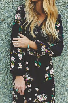 You can wear this black dress with color flowers on it. for summer and for fall also. Versatile dress.