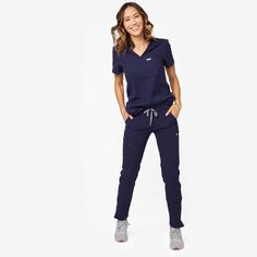 Polish your professional look with our most stylish scrub pant yet. The Yola has a tapered, skinny fit for a contoured silhouette and plenty of multi-tasking pockets (its front-zip utility leg is perfect for your phone! Skinny Legs, Skinny Fit, Navy Scrubs, Black Scrubs, Stylish Scrubs, Scrubs Outfit, Cute Scrubs Uniform, Womens Scrubs, Scrub Pants