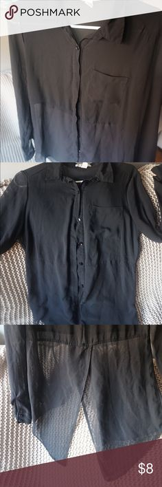 Black Button-down Blouse A black button down top that is semi see-through from the waist down and the sleeves. Has a slit in the back. Forever 21 Tops Blouses