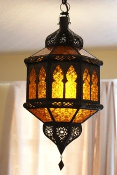 moroccan style lighting. the metal frame has been perforated in a traditonal moroccan style to create very effective diffusion of light lighting