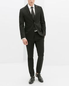 ZARA - MAN - BLACK SUIT  BLAZER WITH CAMOUFLAGE LINING, $189.00 STRETCH SHIRT, $59.90 SUIT TROUSERS, $89.90
