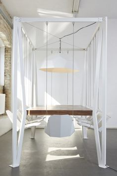 ok, you know you want to try this for at least one meal!  Fun! :)  Dining table with swing-chairs
