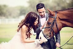 Such a pretty shot (love the bride's gloves) and what a noble steed.