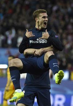 Atletico Madrid's French forward Antoine Griezmann celebrates after scoring during the Champions League quarter-final second leg football match Club Atletico de Madrid VS FC Barcelona at the Vicente Calderon stadium in Madrid on April 13, 2016.