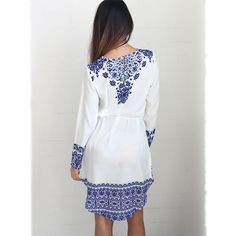 You+can+wear+our+blue+and+white+porcelain+pattern+dress+just+about+anywhere.+Wear+it+to+class,+to+your+next+party,+or+for+a+day+out+with+the+girls.+Pair+it+with+your+favorite+shoes+and+a+cute+bohemian+inspired+hat+and+you're+off!++In+addition+to+the+printed+design,+you'll+love+the+long+sleeves+as...