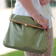 Green Top-Clasp Clutch Crossbody Not Patent, but definitely has a sheen to it - the back image I reflecting the shine, not a distressed look | front has a couple indentions made from chain during storage (would probably pop out over time) | approx. 8 inches tall (when closed) + 11 1/2 inches long Bags Crossbody Bags
