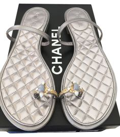 8560ee324491f Chanel  850 2015 Cc Logo Jeweled Toe Ring Quilted Flat 38 Silver Sandals.  Get the