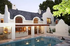 What do you think of my quaint home in Constantia? There is a little too much paving if you ask me, so I'm going to be replacing that with some green grass. You should take the time to look at the kitchen. I think a kitchen makes the home. Double Storey House, Cape Dutch, African House, Dutch House, Mediterranean Style Homes, Dutch Colonial, Courtyard House, Tropical Houses, Interior Architecture