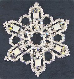 Snowflake made with Tila Beads. Designed by Sandra Halpenny