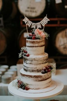 Rustic wedding cake idea - three-tier naked cake with berries + baby's breath {Krizel Photography}