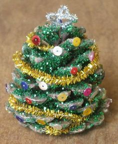 Pinecone christmas tree. Adorable as an ornament or a sweet little decoration. Easy and affordable to make!