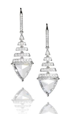 A pair of diamond pendent earrings The triangular-cut diamonds, weighing 2.25 and 2.24 carats, suspended by tapering rows of brilliant-cut diamonds, to a similarly cut diamond surmount, mounted in 18k white gold, remaining diamonds approximately 0.50 carat total, length 3.5cm