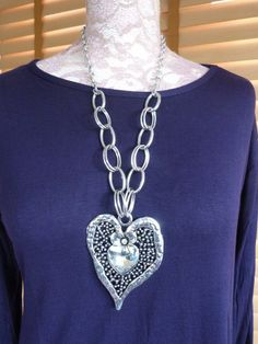 Chunky heart necklace with beautiful flower detail