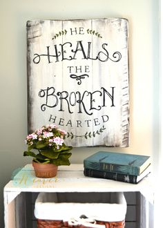 He heals the broken hearted. Unique hand-painted sign made from reclaimed barn wood by Aimee Weaver Designs.