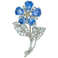 Stunning 1930s Sapphire Diamond Platinum Flower Brooch | From a unique collection of vintage brooches at https://www.1stdibs.com/jewelry/brooches/brooches/