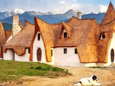 The hotel's owners, Razvan and Gabriela Vasile, sold their home in Romania's capital city of Bucharest in order to bring this clay fairytale castle into 03 Clay Houses, Fairytale Castle, Fantasy Places, Concept Home, Hotel S, Perfect Place, Monument Valley, Fairy Tales, Building