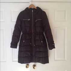 Michael Kors Down Long Winter Coat Love this winter coat because it's 1. Warm and 2. Is one of the only winter coats that doesn't make you look like a huge marshmallow. Very flattering winter coat. Only worn a few times, perfect condition. Real down. Size M. Dark brown color, almost black. Michael Kors Jackets & Coats