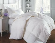 Cozy, fluffy white down comforters are my absolute favorite.