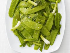 Yummm I love Snow Peas even got one of my best friend hooked on them.....Im going to have to try this!!  Glazed Snow Peas Recipe : Food Network Kitchens : Food Network - FoodNetwork.com