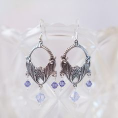 Lovely Art Nouveau style earrings featuring tanzanite and provence lavender genuine Swarovski crystals. The periwinkle and purple beads, along with the vintage floral design, glimmer and sparkle adding a spring touch spring to any outfit.
