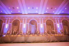 Long Feasting Wedding Head Table with Gold Linens and Tall Ivory Centerpieces and Tall Taper White Candles and Pink Uplighting at Downtown St Petersburg Wedding Venue Vinoy Renaissance Sunset Ballroom | St. Pete Wedding Photographer Limelight Photography
