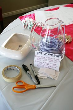 Size Up the Belly: Cute your ribbon to the length you think the belly with measure.  Attach a piece of tape with your name on it and put it in the bowl.