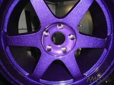 A wheel in Candy Sparkle Purple powder coating. My mom-mobile of a car isn't nearly cool enough for these, but I'm guessing other metal can be powder-coated. Sparkly purple toilet flusher handle? Boom. Fabulous fecal traces!