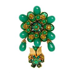 """floral motif brooch with a luscious array of green art glass drops and prong-set green crystals within Russian gilt metal mounts. Signed """"Stanley Hagler N.Y.C"""" by Ian St. Gielar."""