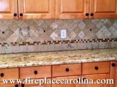 TOP STAR Granite 5 2 13 http://www.fireplacecarolina.com  Granite Countertops Installed in Charlotte NC  60/40 sink  Half bullnose edge  4x4 Light Travertine tiles   Medium colored kitchen cabinets  See Our GRANITE COUNTERTOP PACKAGE DEAL