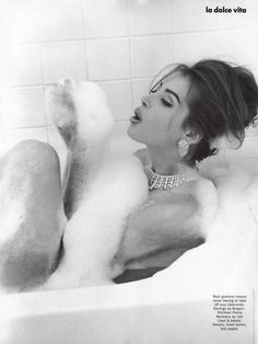 Christy Turlington by Steven Meisel, 1989, bathing with her diamonds and glam make-up