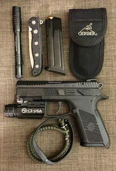 EDC Cz p-07, gerber multi tool, extra magazine 15rds, crkt m16-132, stream light protac, paracord & Fitbit