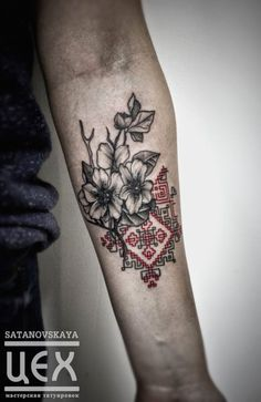 Mixing traditional embroidery with flowers, tattoo by Anastasia Satanovskaya.   flowers geometric black grey red