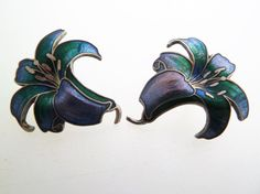 Beautiful curvy lily flower cloisonné enamel earrings in shades of blue and blue/green with just a hint of purple on silver tone. They have push