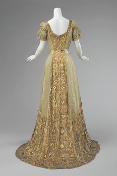 """American ball gown (1910) by Mrs. Osborn Company made of silk  Met's description: """"The over-the-top expression of opulence seen in this ball gown worn by a prominent member of the Astor family is a testament to the degree of ostentation required at certain events in order to stand out from the crowd. The dense sequin and bead embroidery on the gown would have created a beautiful shimmering effect."""""""