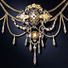 """""""A rare, fanciful and consummately Victorian antique necklace adorned with seed pearls and accented with black enamel....A truly splendorous and exemplary nineteenth-century jewel."""""""
