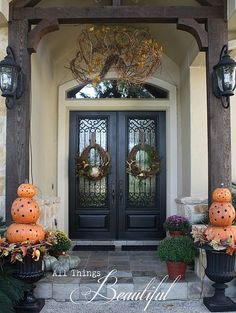 Lovely natural fall wreaths!!! Bebe'!!! Great pumpkin topiareies!!! Combine for a festive fall display on the front porch!!!