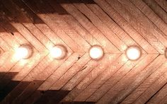 """Fish Electrolier by Katy Parnello - Re-purposed wood and soft-lights measuring 24"""" x 48"""""""