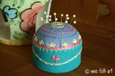 8 Hand Embroidered Pin Cushions