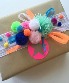 Here's another fun festive idea. Use colourful pom-poms to decorate Christmas gifts