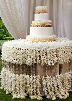 """How amazing is this """"tablecloth"""" made out of fresh white orchids and the ombre layered wedding cake! Click to check out the full wedding."""