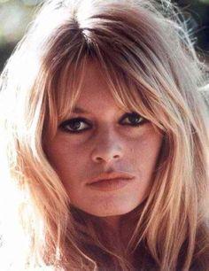 Bardot. Center bangs, slightly tapered. Long layers.