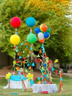 """This issue of Festivities Magazine has an entire feature on decorating an outdoor children's party using large 36"""" latex balloons and small balloons and streamers."""