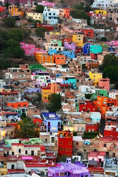 Guanajuato in Mexico, which is built in a valley and creates a giant happy colorful outdoor space. Every building is a different bright colo...