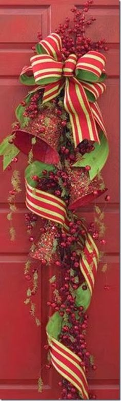 Christmas wreath -Not a tutorial- I wish-- find a berry garland - glitter coat bells and wire them to the garland. Make a bow with wired ribbon but don't cut a tail. Wrap the wired ribbon around and fluff it till it fits right.