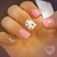 Just enough cute to really stand out but In a subtle way. Definitely noticeable but not distracting. It's a yes. Pink base. Middle finger white, with cross design. And silver pinky. OETE ♡