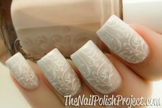 Gradient nude and white nails with subtle stamping.