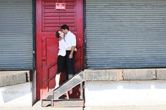 Cute engaged couple kissing near red door in Meat Packing District of New York | Engagement photoshoot | New York City Wedding Photographers | NY, NYC | Anna Rozenblat photography | www.AnnasWeddings.com