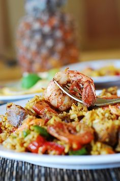 Easy paella with chicken, shrimp, and sausage.... I always think this ...
