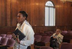 Sandra Lawson prays at the Bristol Jewish Center. Photo by Kim Weimer/Staff Photographer Bucks County Courier Times, courtesy of Sandra Lawson