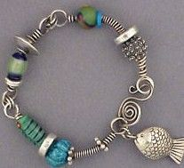 Wire and bead bracelet with fish charm